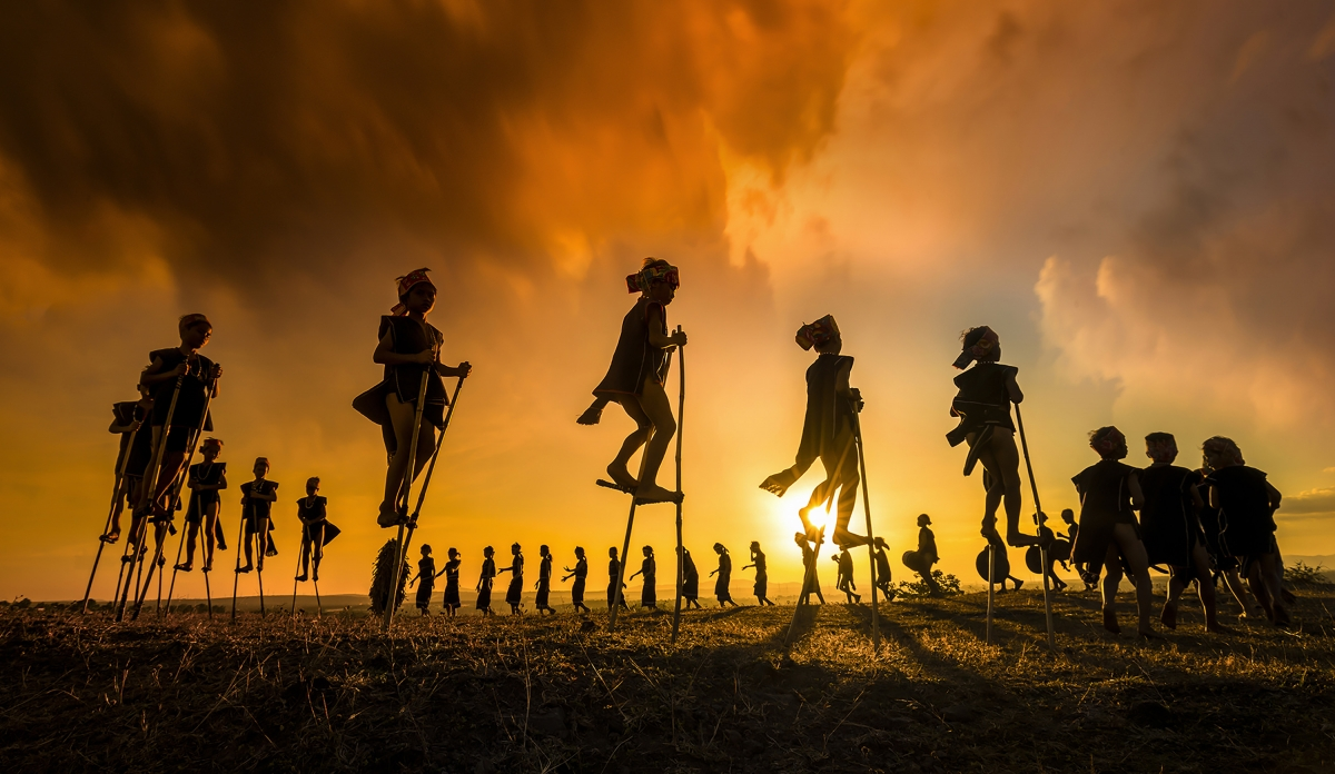 Phan Thi Khanh from Ho Chi Minh City wins second runners-up titles in categories such as Travel, Lifestyle, Documentary, Street, and Portrait. The image features a group of children playing at a traditional festival held in the Central Highland province of Gia Lai.