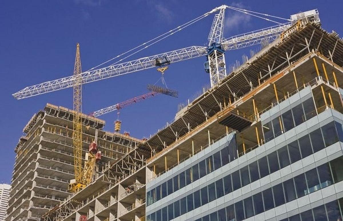 Hiện các thủ tục hành chính liên ngành trong cấp phép xây dựng và các thủ tục liên quan kéo dài hơn so với quy định. (Ảnh: KT)