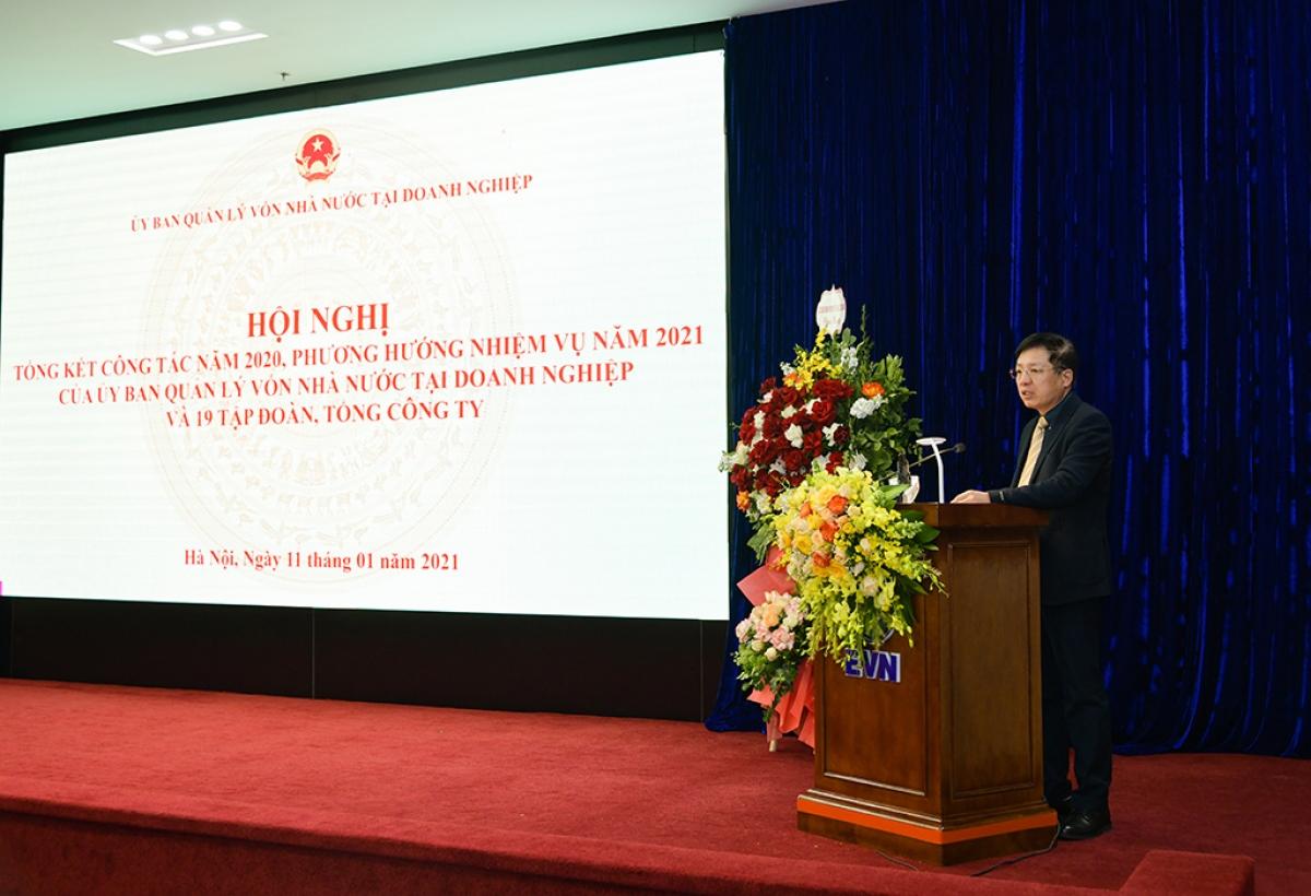 Phó Chủ tịch Ủy ban Quản lý vốn nhà nước tại doanh nghiệp Hồ Sỹ Hùng báo cáo tổng kết công tác năm 2020 của Ủy ban và các Tập đoàn, Tổng công ty trực thuộc.