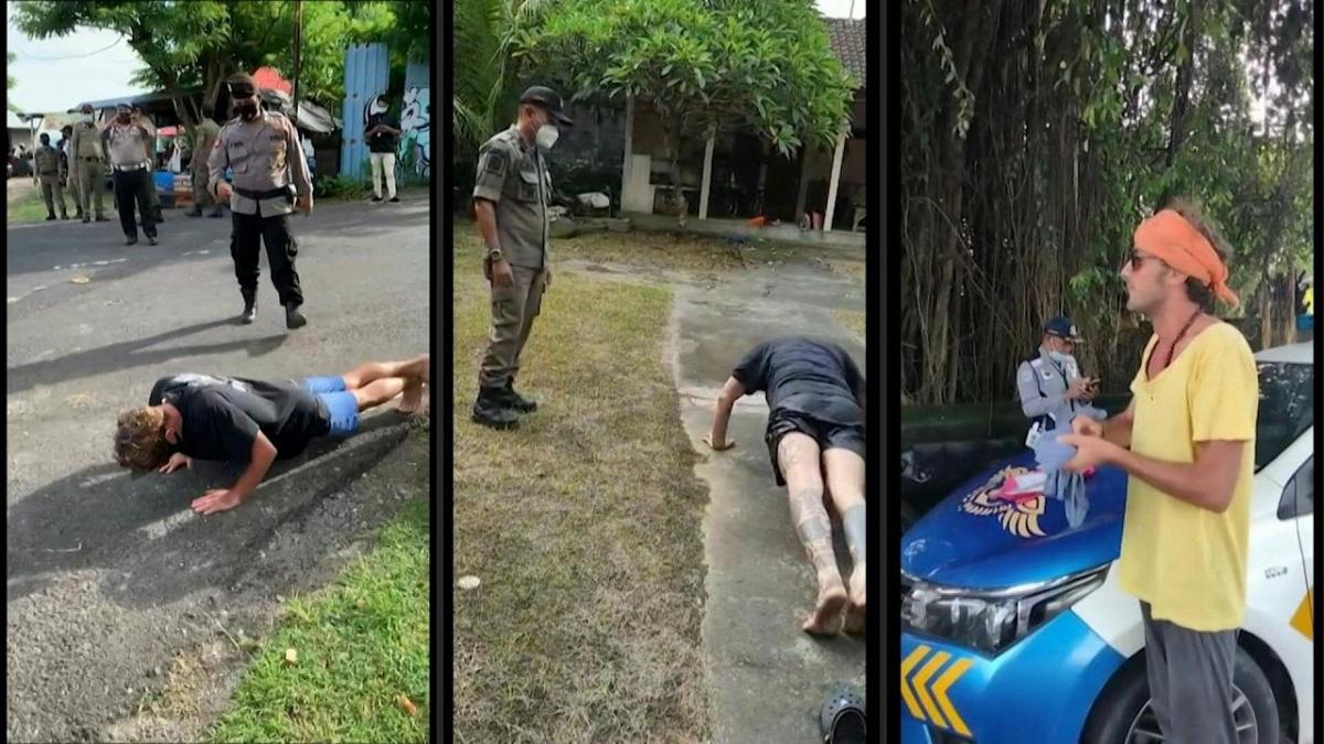 Cảnh sát Bali giám sát du khách chống đẩy vì không đeo khẩu trang. Nguồn: AFP