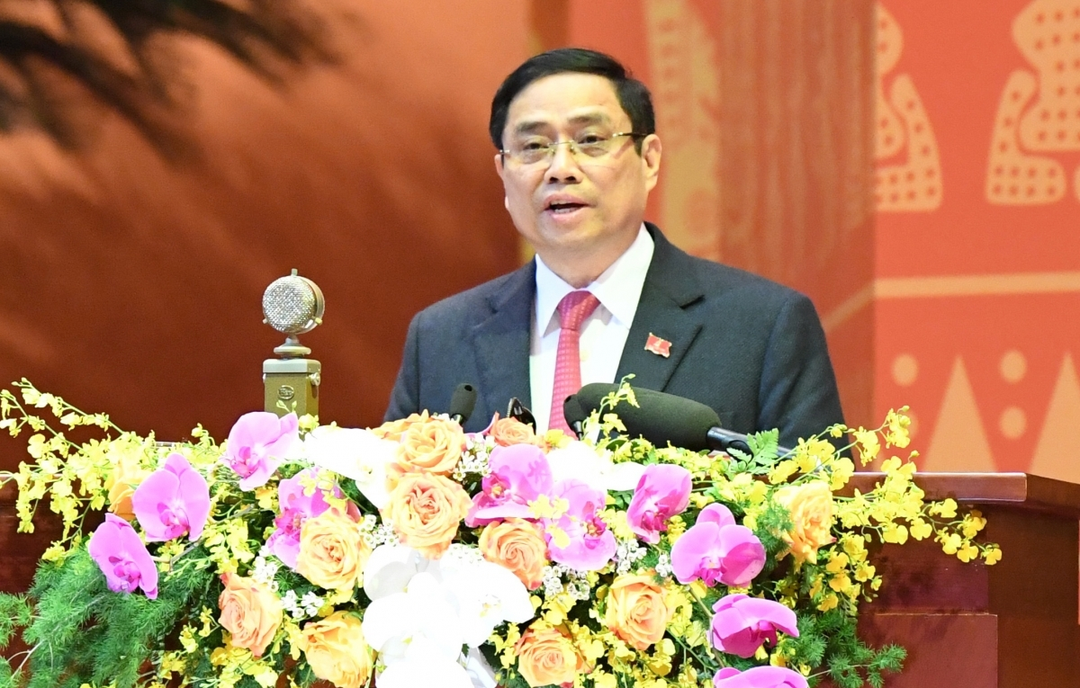 Pham Minh Chinh, Politburo member, secretary of the Communist Party of Vietnam (CPV) Central Committee, and head of the CPV Central Committee's Organisation Commission, presents a draft of working regulations and election rules at the event.