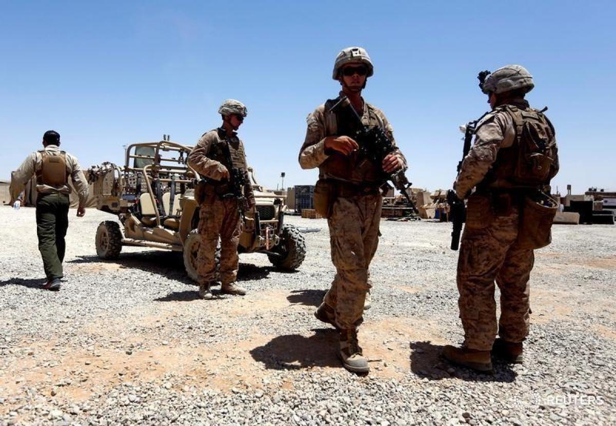 Mỹ tiếp tục cắt giảm quân đồn trú ở Afghanistan và Iraq. Ảnh: Reuters