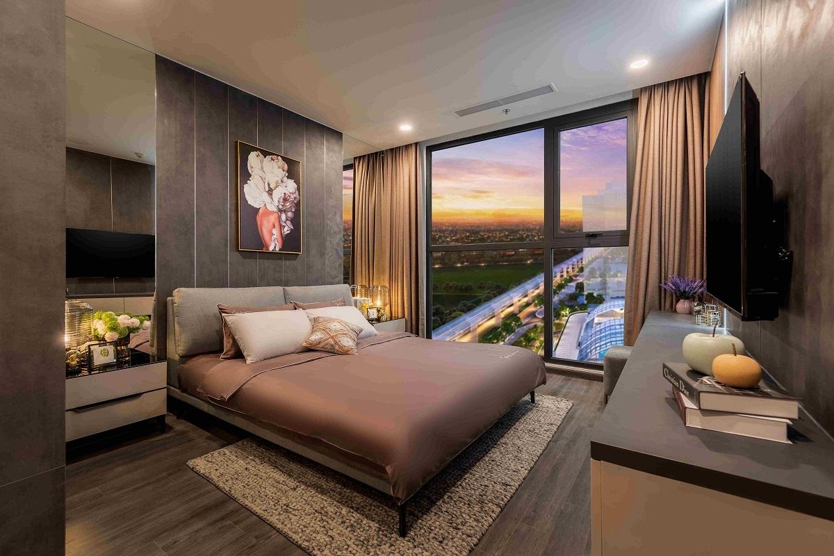Thiết kế cửa kính tấm lớn mở ra tầm nhìn trọn vẹn, đắt giá như tại các khách sạn 5 sao cho phòng ngủ căn hộ mẫu Ruby.