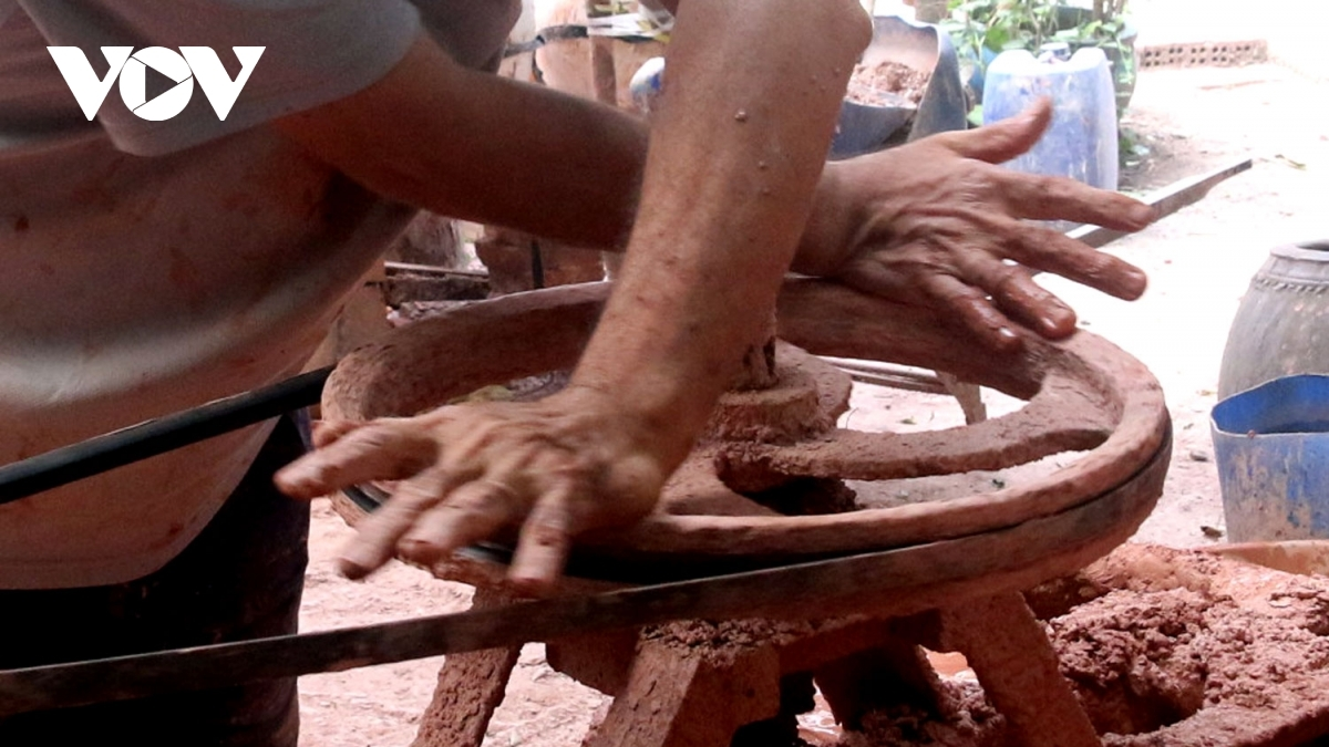 The first step in making the items is to mix clay.