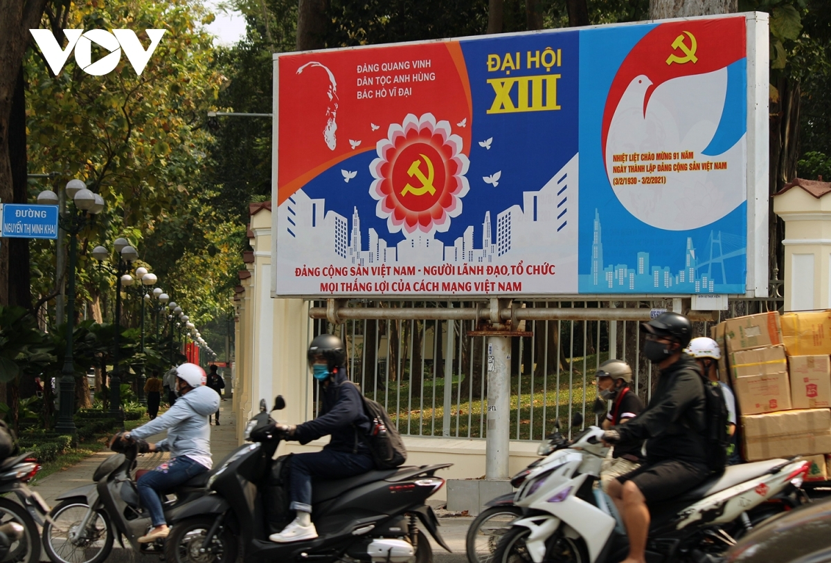 A large propaganda poster on Nguyen Thi Minh Khai street in District 1 offers praise for the leadership of the Communist Party of Vietnam and for President Ho Chi Minh.