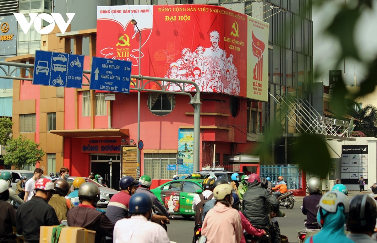 A major propaganda poster can be seen Nam Ky Khoi Nghia street, drawing plenty of attention from pedestrians.