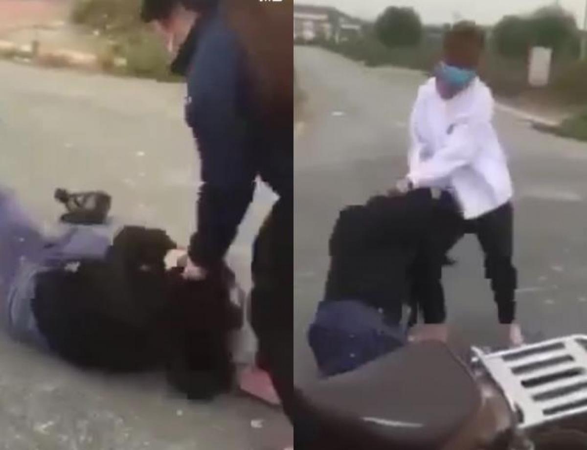 Nữ sinh bị bạn đánh hội đồng ở Hà Đông. Ảnh cắt từ clip.