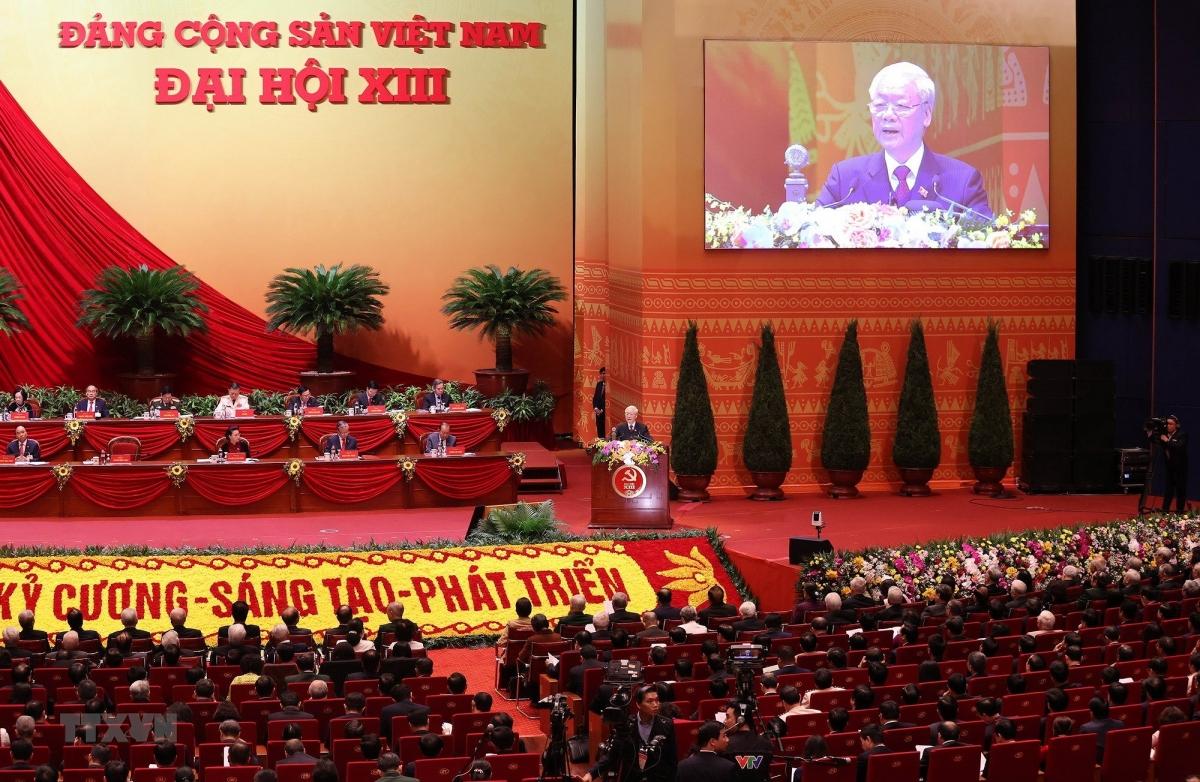 Đại hội nghe Tổng Bí thư Ban Chấp hành Trung ương Đảng, Chủ tịch nước CHXHCN Việt Nam Nguyễn Phú Trọng đọc Báo cáo chính trị của Ban Chấp hành Trung ương Đảng khóa XII và các văn kiện trình Đại hội. (Ảnh: TTXVN)