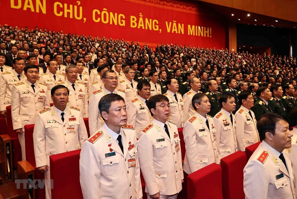 They salute as the national anthem is played at the National Convention Centre in the capital city (Photo: VNA).