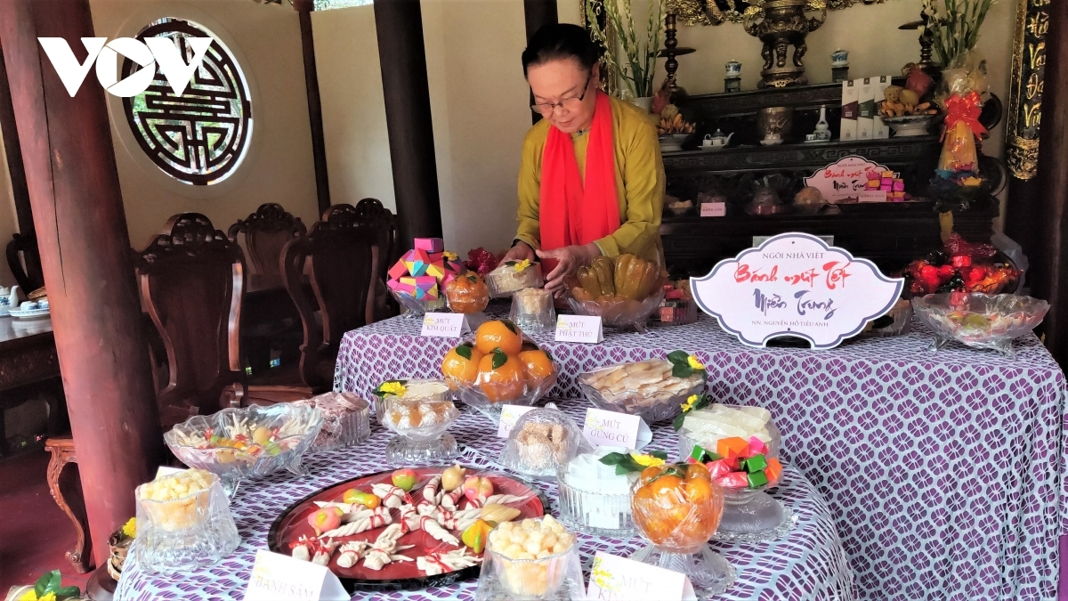 During the duration of the festival 150 booths are present to showcase the food and delicacies of each region nationwide. Photographed is artisan Ho Dac Thieu Anh arranging the traditional food of the central region.