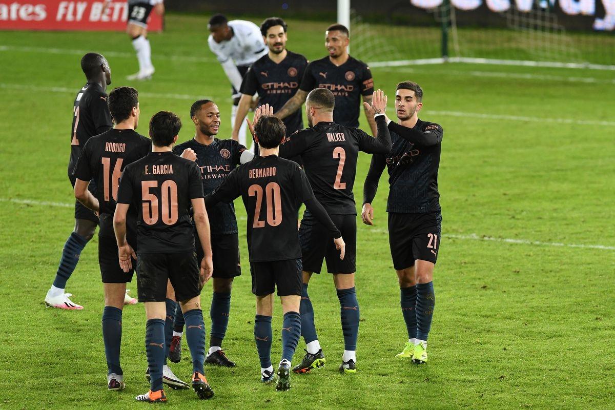 Hạ Swansea, Man City tiến vào tứ kết FA Cup với hàng loạt kỷ lục của bóng đá Anh. (Ảnh: Getty).