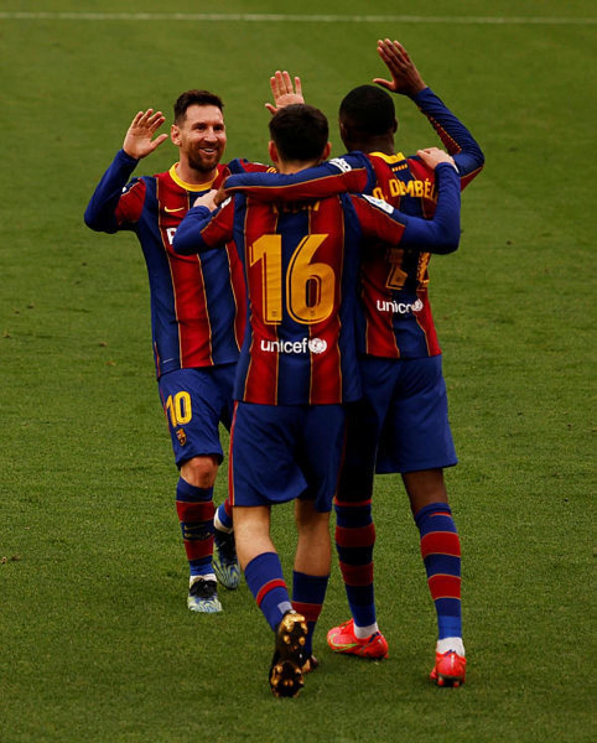 Messi ăn mừng chiến thắng cùng các đồng đội. (Ảnh: Getty).