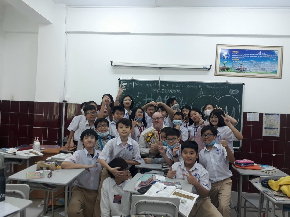 Francis (middle) and his students
