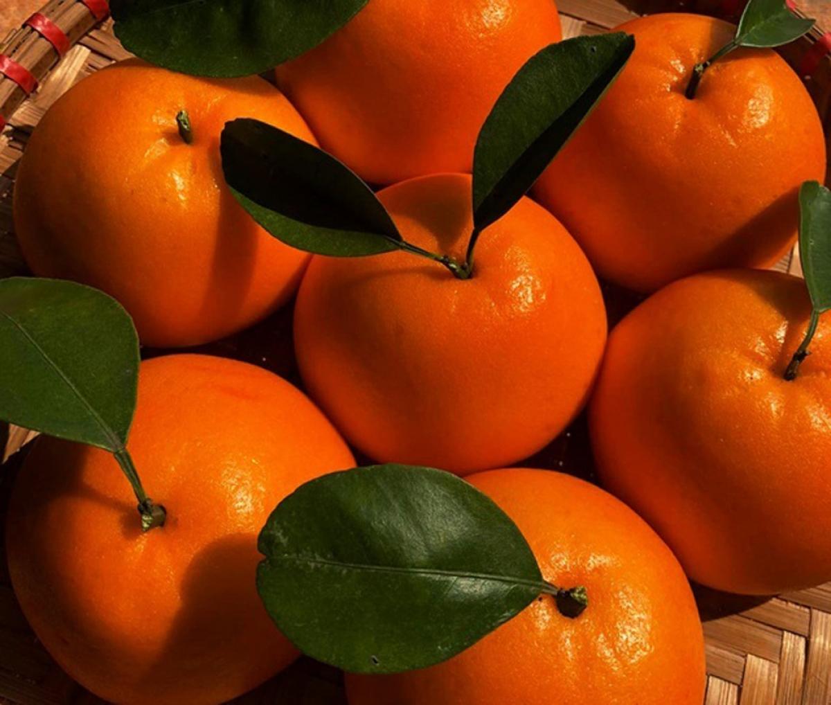 Bánh bao được tạo hình giống hệt trái quýt rất đẹp mắt. (Ảnh: VTC News)