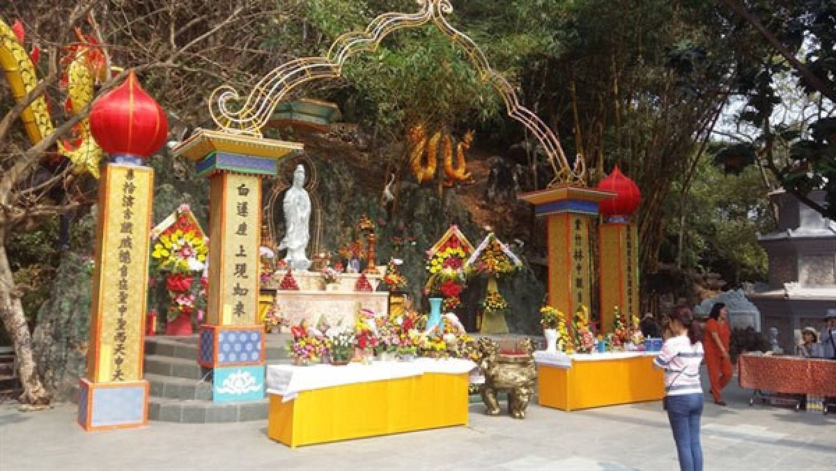 A visitor prays at a pagoda in Ngu Hanh Son (Marble Mountains) in Da Nang.