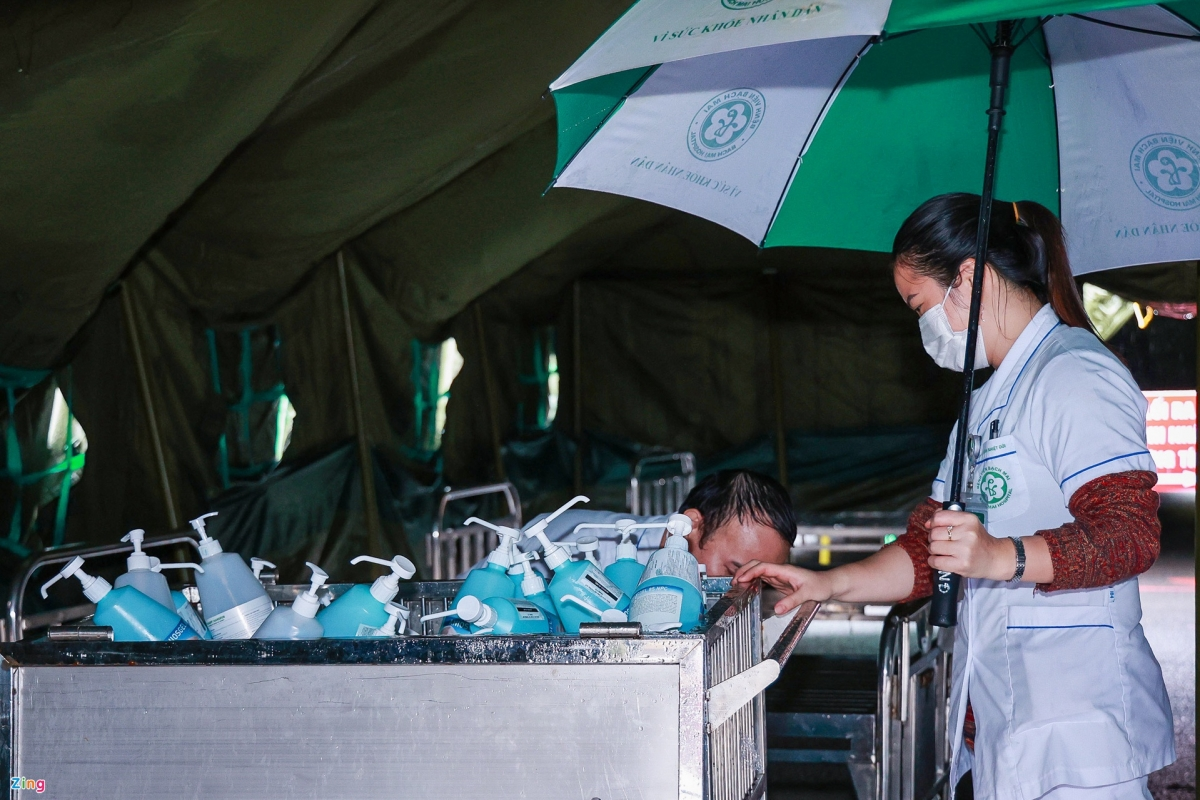 Workers prepare all necessary equipment for the field hospital.