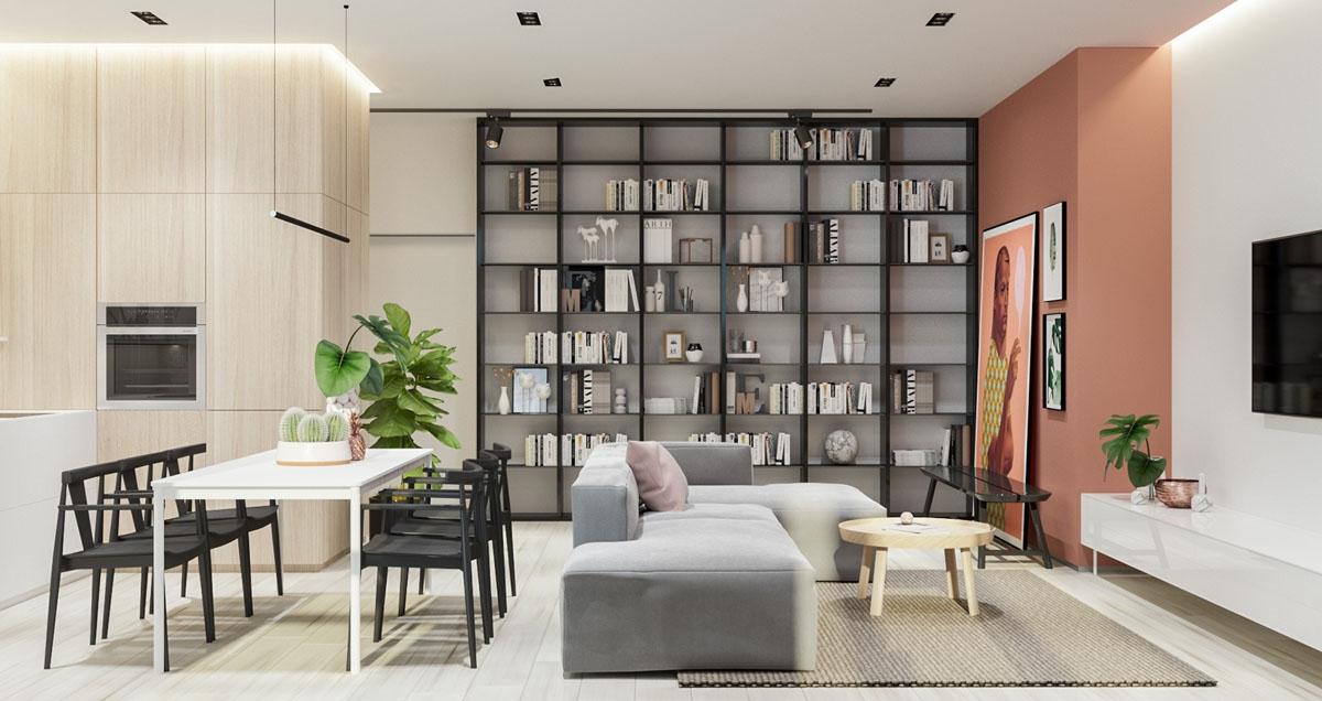Đây là một sự kết hợp hoàn hảo giữa phòng khách và phòng ăn, khi sự phân chia không gian không phải sử dụng tường hoặc vách ngăn mà thu hút sự chú ý vào giá sách lớn, vừa có tác dụng trang trí lại vừa bổ sung thêm diện tích lưu trữ.