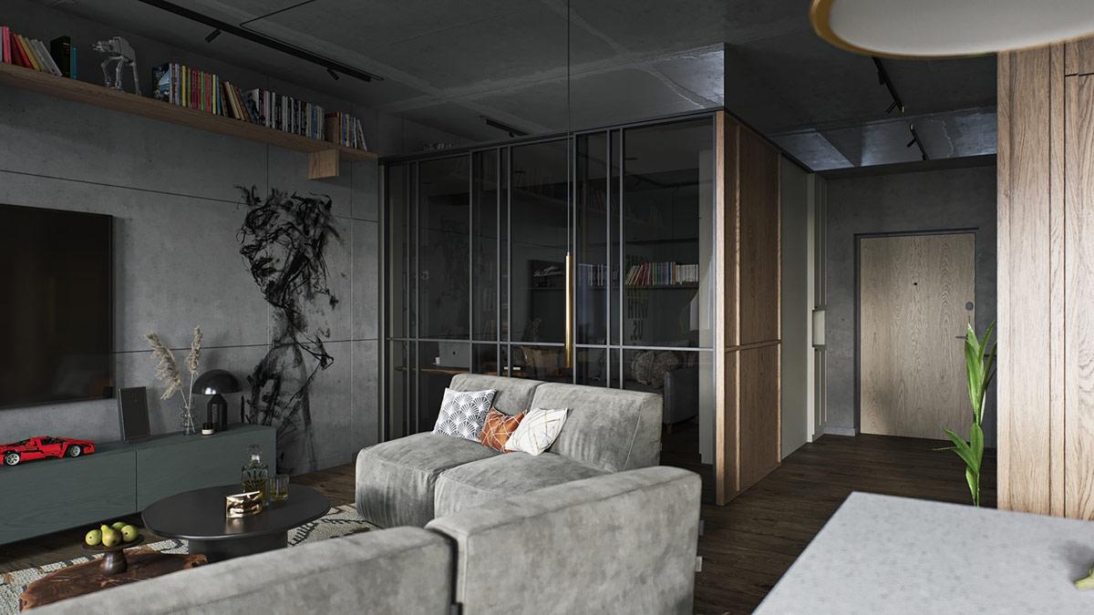 Không gian làm việc được ngăn cách với phòng khách bằng bức tường kính giúp mở rộng không gian.