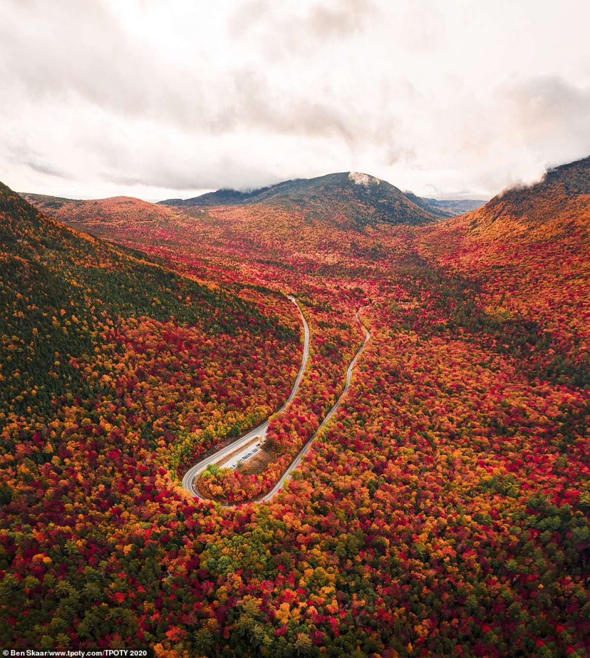 17-year-old Ben Skaar wins the young travel photographer of the year with a photo showing a beautiful landscape in the autumn in New Hampshire in the US.