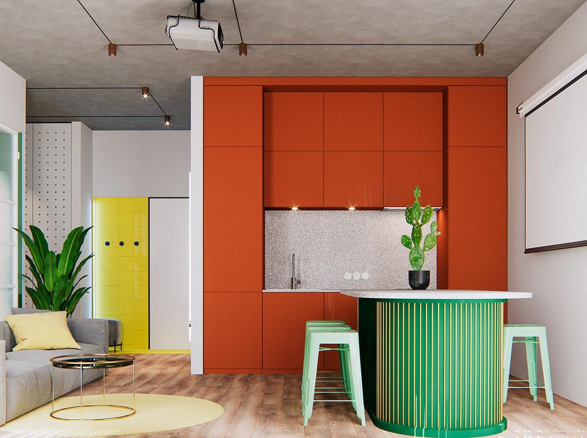 Chủ nhân căn bếp này hẳn là người yêu màu sắc, trẻ trung với sự phối hợp hài hòa giữa mfu xanh của bàn bar, mảng tường điểm nhấn màu vàng đến tủ bếp màu cam sặc sỡ.