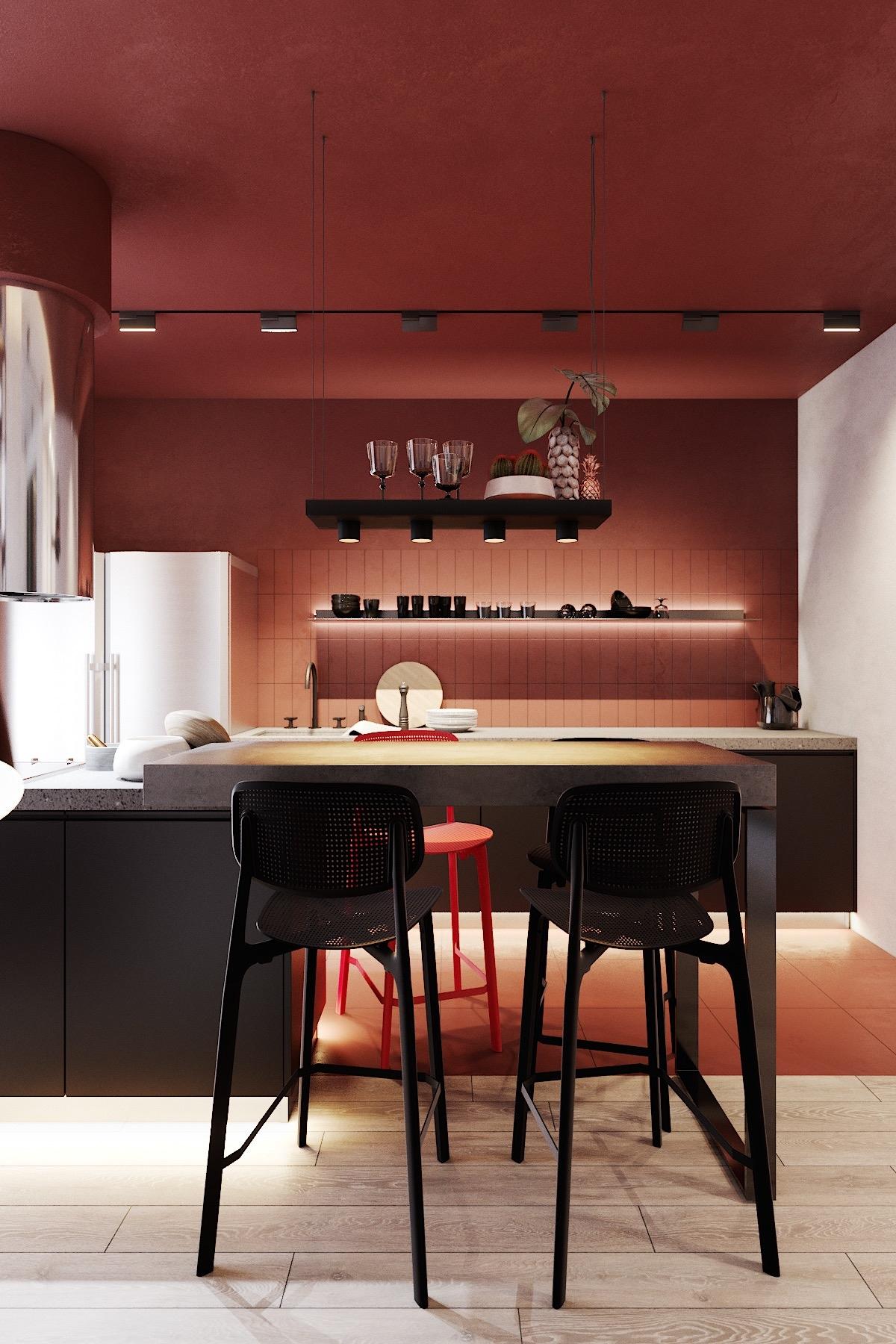 Nồng nàn, pha chút bí ẩn, quyến rũ, là ấn tượng của khách khi bước vào căn bếp này. Màu đen của bàn ghế bar rất hợp với tông đỏ mận của tủ bếp.