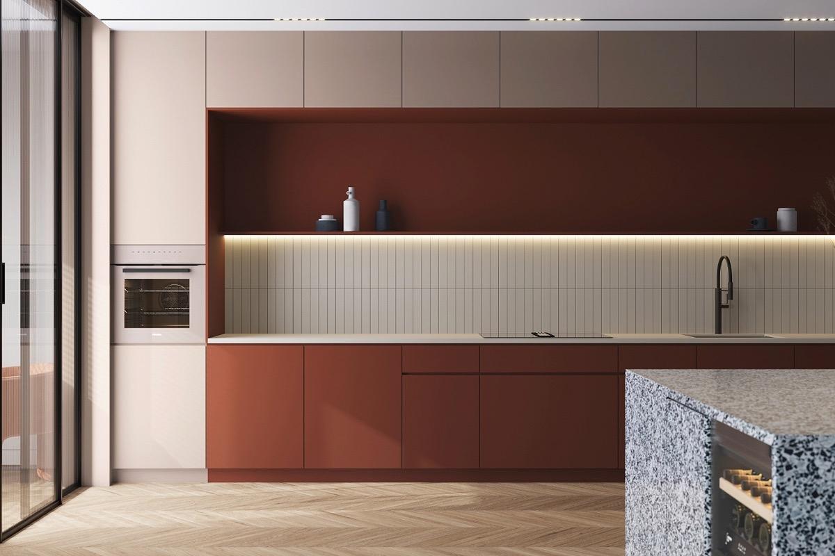 Điểm nhấn là tủ bếp màu nâu đỏ được làm dịu lại bởi các tông màu trung tính từ bàn bar, gạch ốp đá đến các thiết bị nhà bếp. Kệ bếp mở được phân nhỏ giúp căn bệnh thêm ấn tượng.