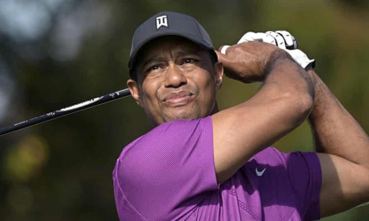 Bị chấn thương nặng sau tai nạn, Tiger Woods vẫn đặt mục tiêu trở lại thi đấu đỉnh cao. (Ảnh: Getty).