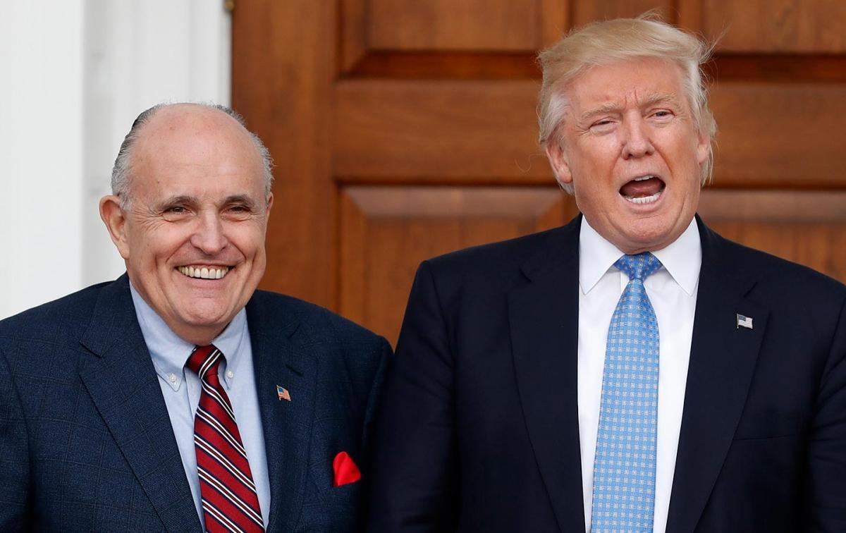 Cựu Tổng thống Trump và luật sưRudy Giuliani. Ảnh: AP