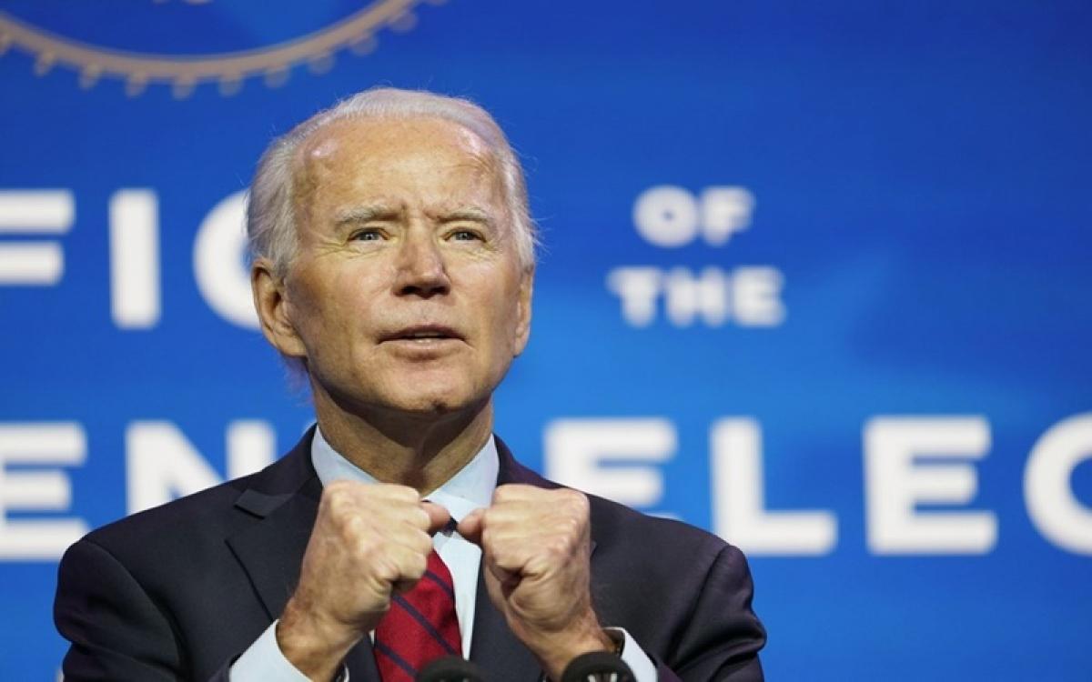 Ông Biden đã và đang thực hiện được khá nhiều cam kết. (Ảnh: Reuters)