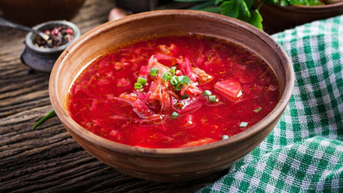 """""""Chunks of tender beets swim in brilliant red broth for a soup that's beloved in Ukraine and across Eastern Europe"""", the website says. """"Often topped with a rich dollop of sour cream, borscht is anything but basic beet soup."""" (Photo: Shutterstock)"""