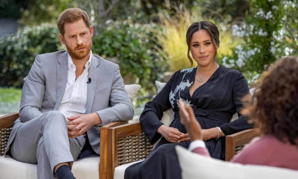 Cặp đôi Harry – Meghan trong cuộc phỏng vấn với Oprah. Ảnh: Reuters