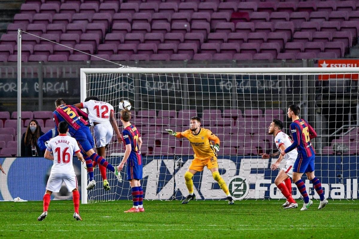 Barca thắng nghẹt thở Sevilla để ẵm vé vào chung kết (Ảnh: Getty).