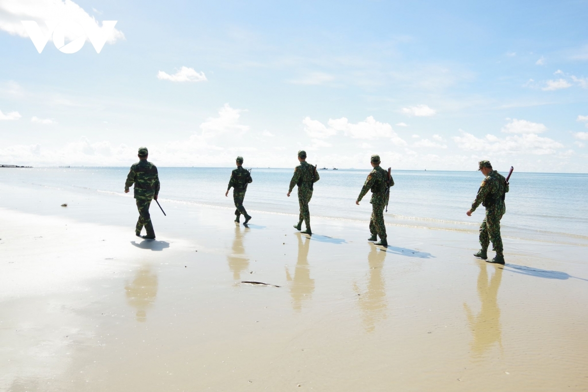 Soldiers stationed at the Nhon Hoi Border Station go on patrol along coastal areas.