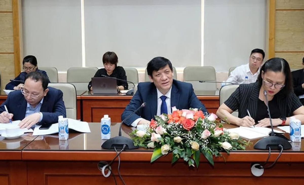 Minister of Health Nguyen Thanh Long speaks during a working session with Chinese, Indian and Russian ambassadors in Hanoi on March 31