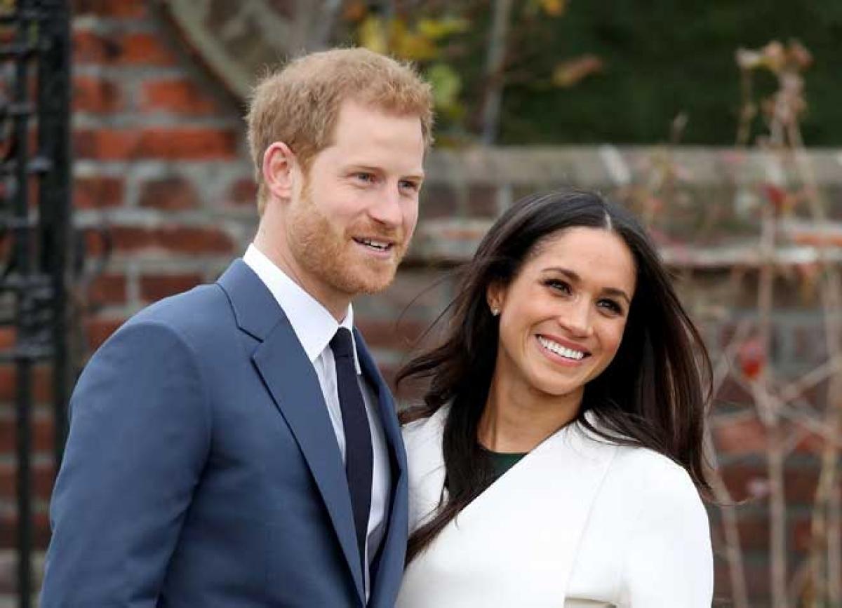 Hoàng tử Harry và Công nương Meghan Markle. Ảnh: AP.