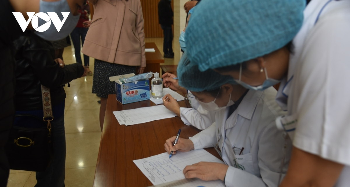 Healthcare workers note down the details and information of all people as they have samples taken for COVID-19 testing.