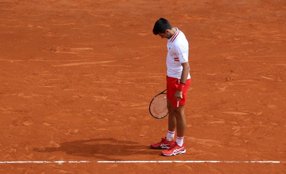 Djokovic thất vọng sau trận thua khó tin trước Evans. (Ảnh: Getty).