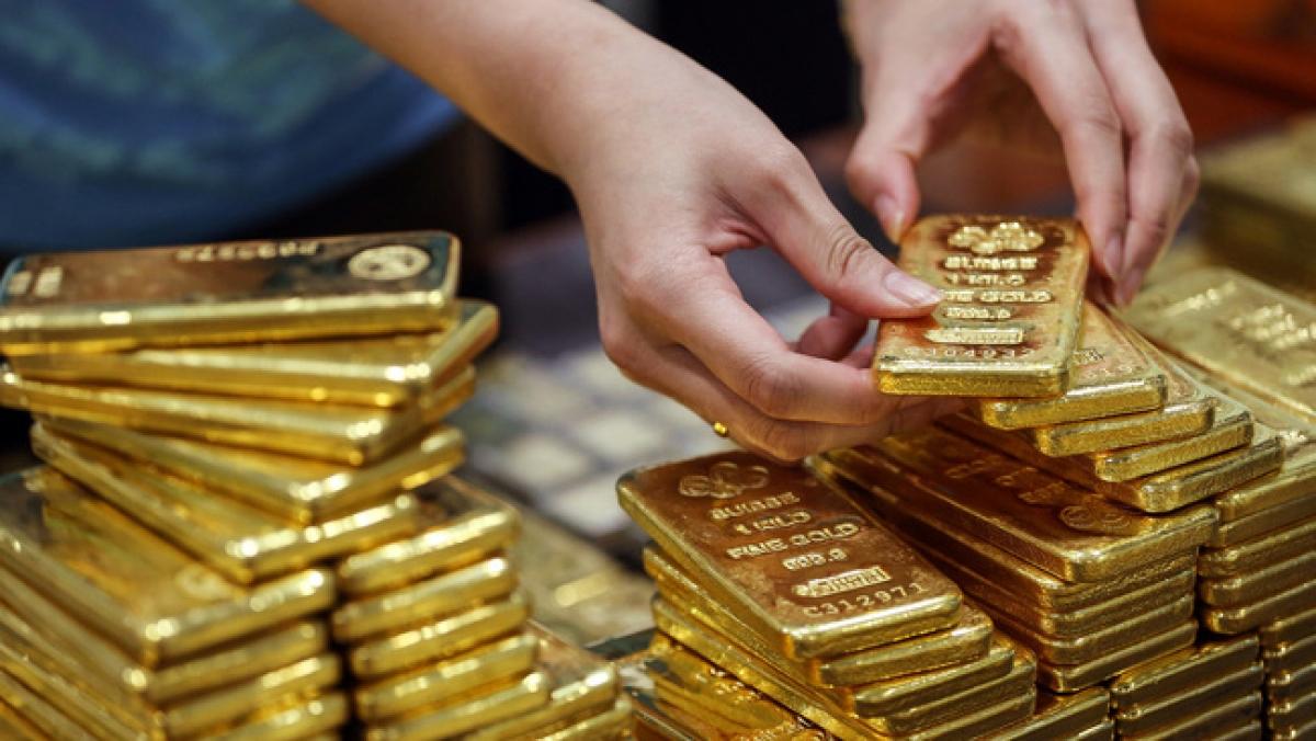 Giá vàng trong nước ngược chiều với vàng thế giới. (Ảnh: KT)
