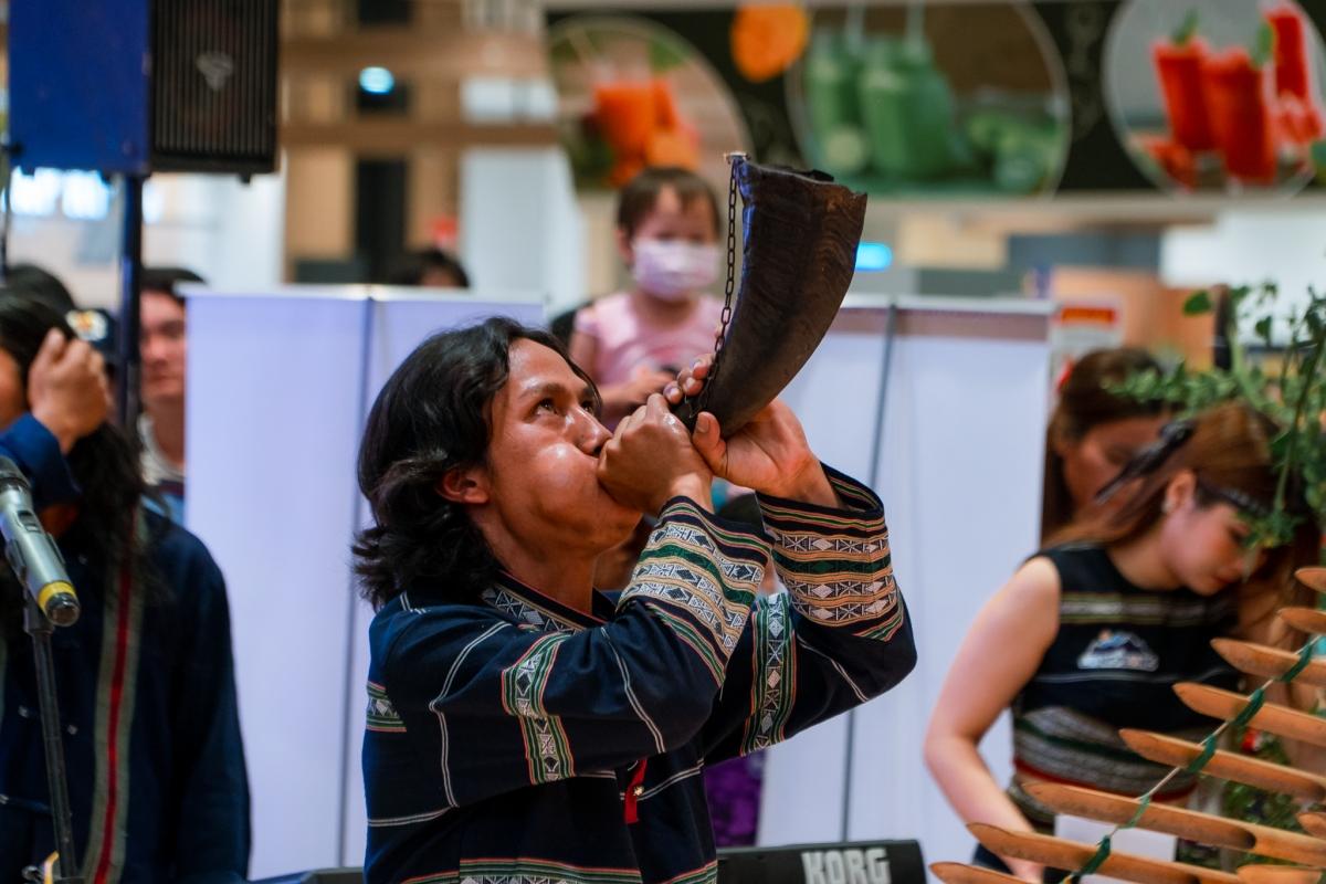 A local artist plays a musical instrument.