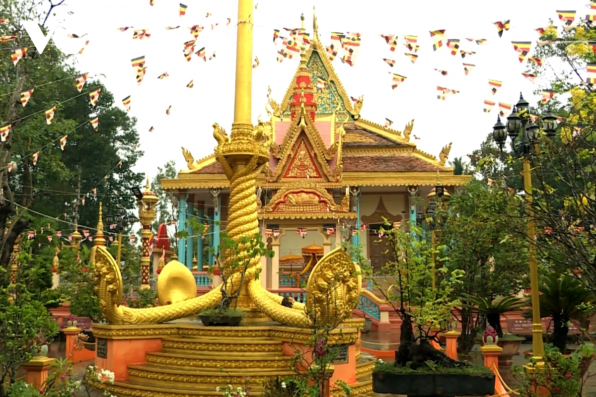 Each of the Khmer pagodas features prominent decorations of flowers and flags.
