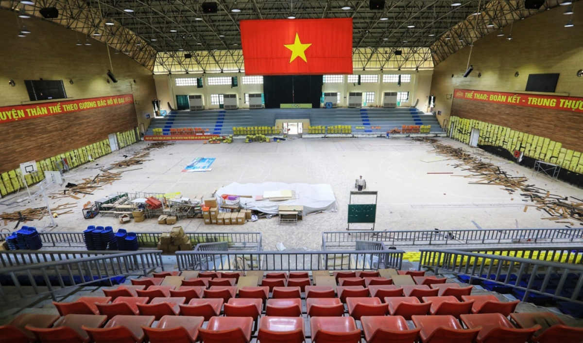 Workers renovate the Thanh Tri competition hall, the venue for basketball at the 31st SEA Games which will take place later this year.