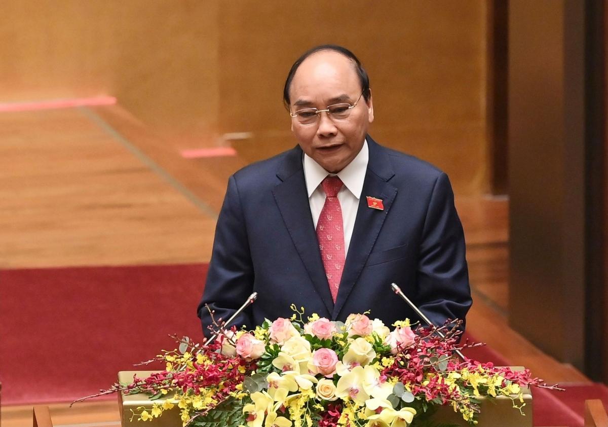 Thủ tướng Nguyễn Xuân Phúc trình bày báo cáo công tác nhiệm kỳ Chính phủ. (Ảnh: VGP)