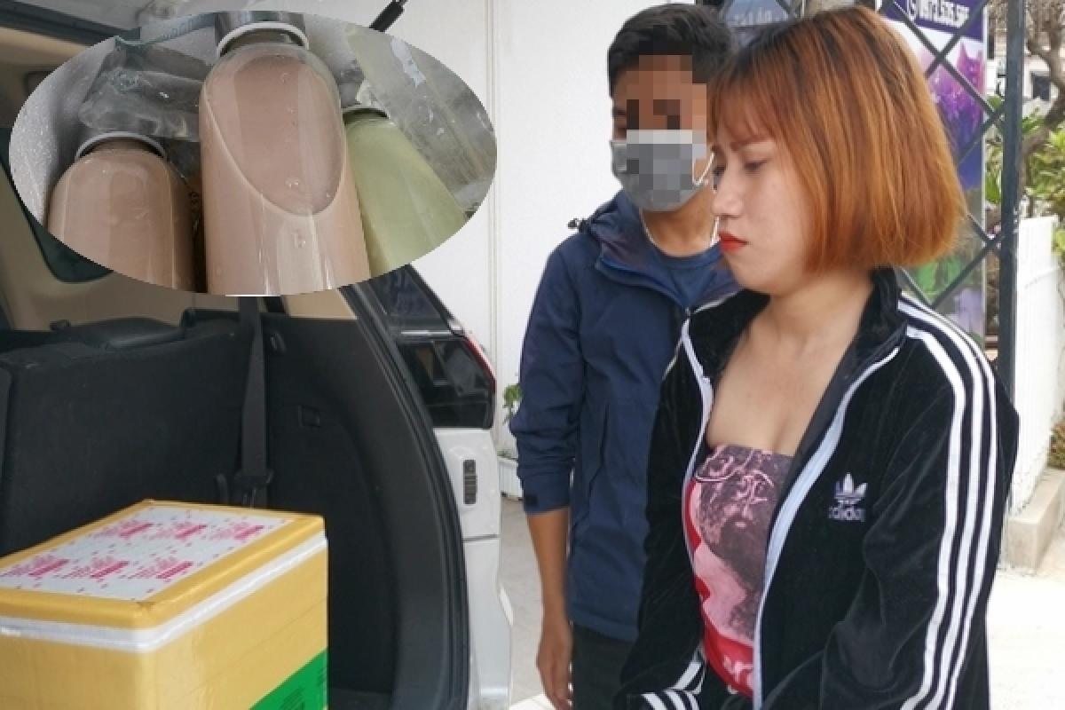 Nguyễn Thị Thái Dung cùng tang vật bị công an bắt giữ.