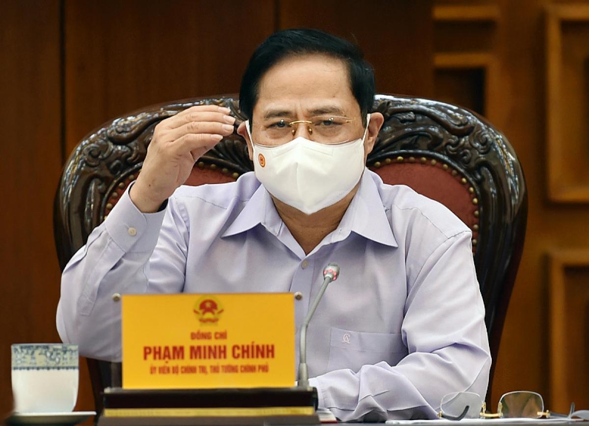 Thủ tướng Phạm Minh Chính chủ trì họp Thường trực Chính phủ về công tác tổ chức bầu cử - Ảnh: VGP/Nhật Bắc
