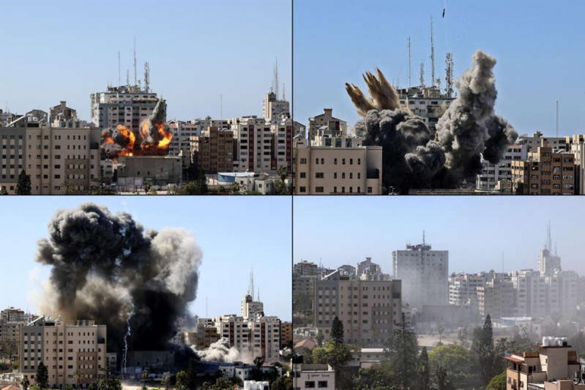 Hình ảnh tòa nhà 12 tầng Al-Jalaa Tower đổ sập sau cuộc không kích của Israel hôm 15/5. Ảnh: AFP