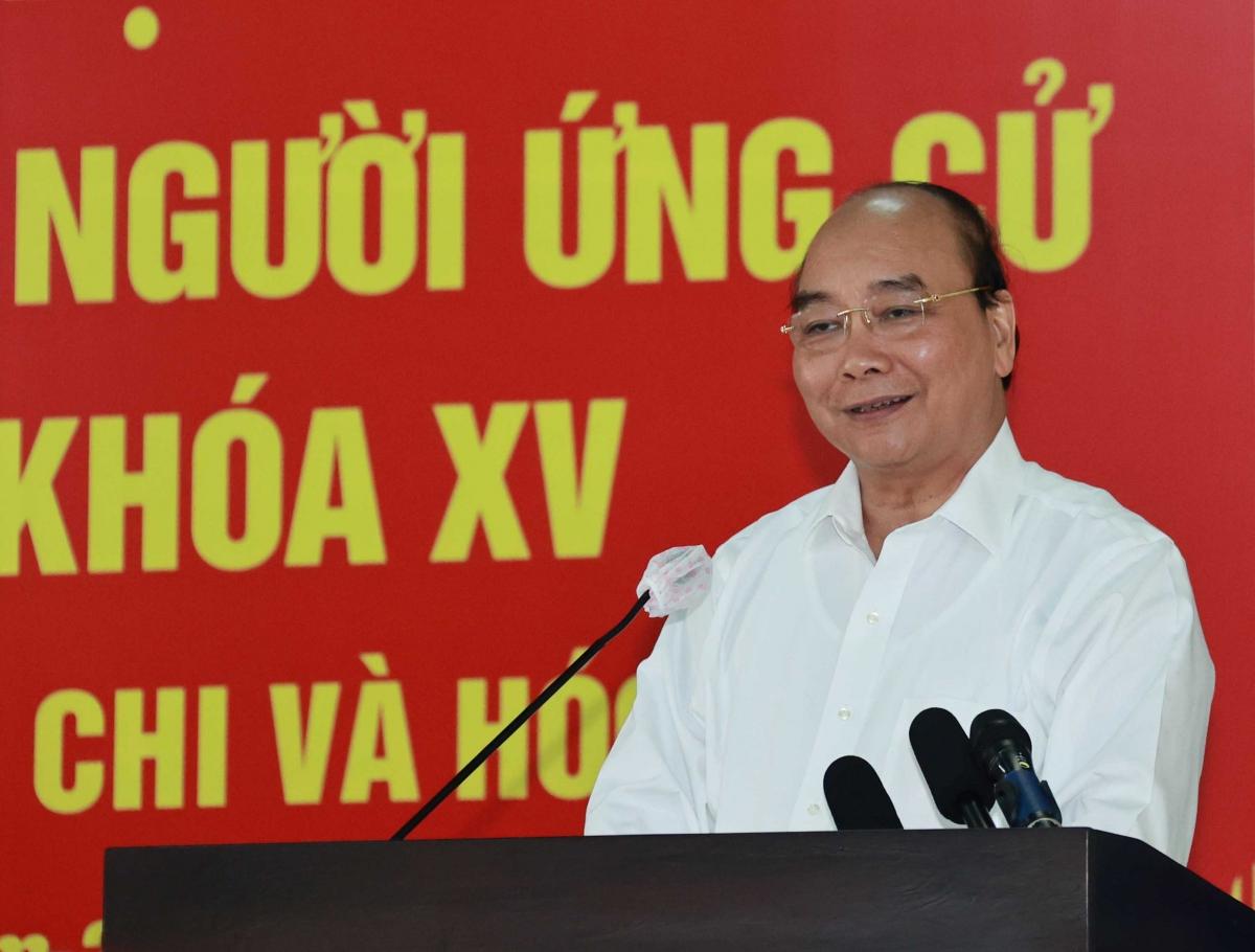 Chủ tịch nước Nguyễn Xuân Phúc trình bày chương trình hành động.