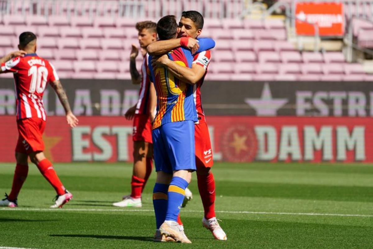 Lionel Messi tái ngộ bạn thân Luis Suarez. (Ảnh: Getty)