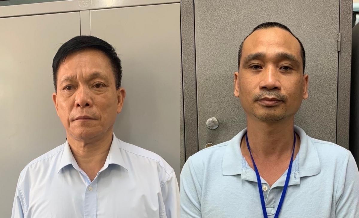 Từ trái sang: Bị can Nguyễn Quang Ngữ và Phạm Thế Tài