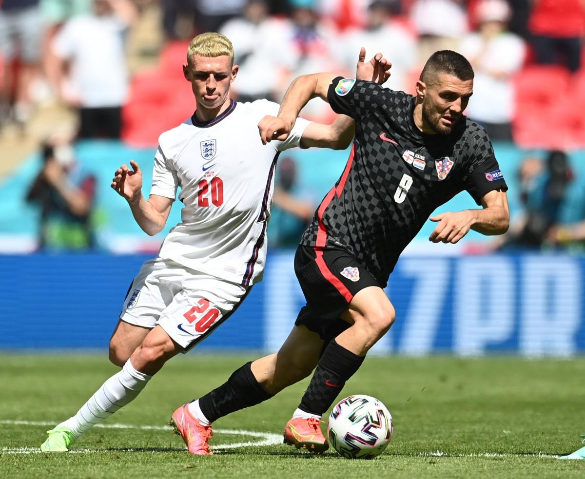 Các cầu thủ Croatia buộc phải đẩy cao đội hình trong những phút còn lại. (Ảnh: Reuters).