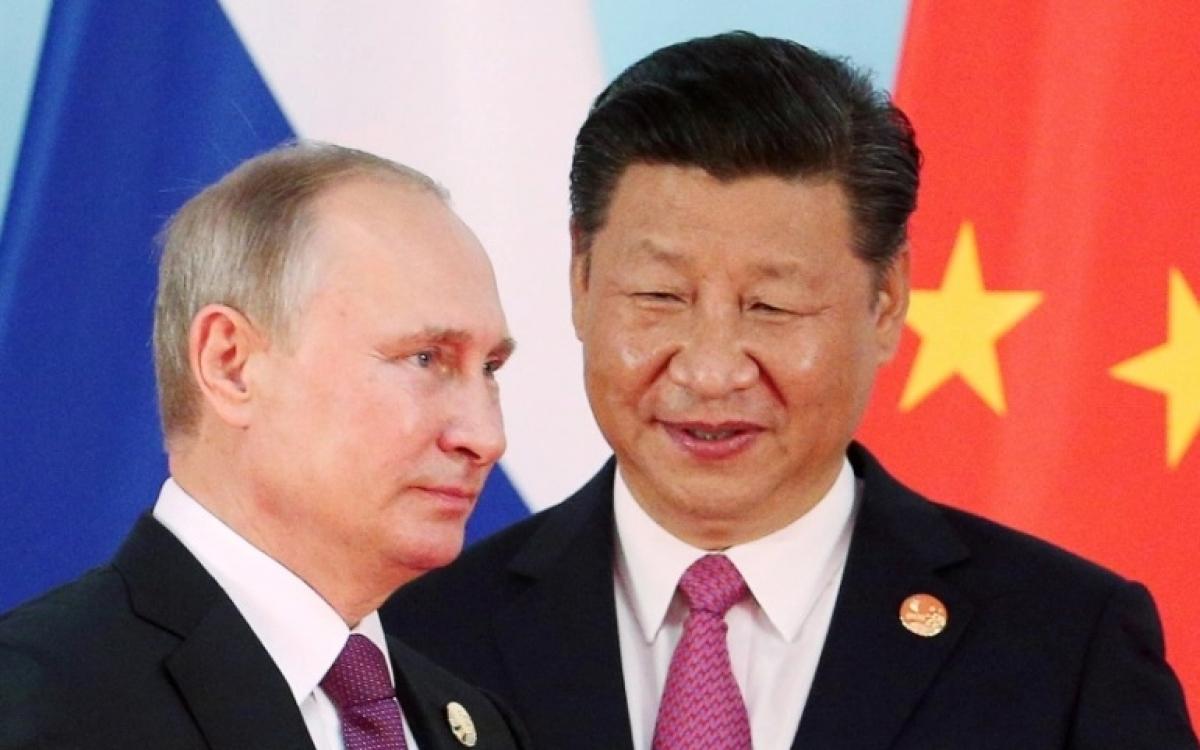 Tổng thống Nga Vladimir Putin và Chủ tịch Trung Quốc Tập Cận Bình. Ảnh: al Jazeera.